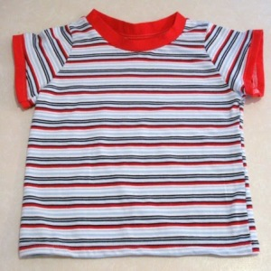 For the kids t-shirt. Repeat the neckline procedure described before with the sleeve cuffs. For the women's t-shirt. Fold the sleeve 1/2 inch and sew along.