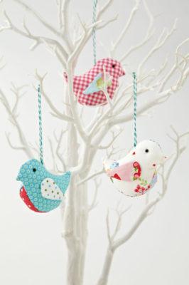 Bird.in_tree1-386x580