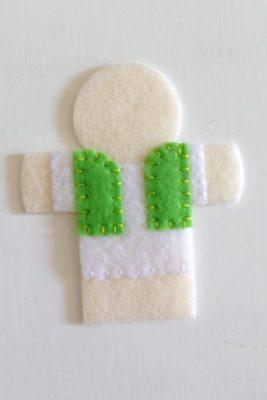 circus finger puppet - green vest