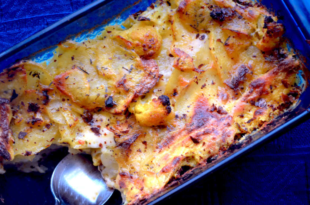 Crispy Cauliflower and Potato Gratin with Creamy Turmeric Sauce